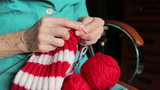 closeup of old womans hands knitting