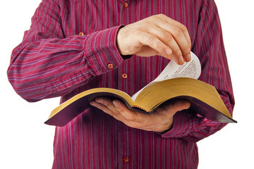 Man reading a Bible isolated on white