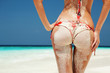 Sexy sandy woman buttocks on the beach background - 50535902