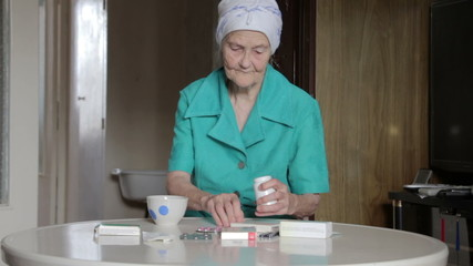 old woman taking pill
