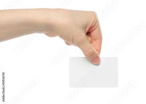 Hand holds business card on white background .