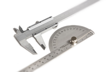 Vernier calipers and protractor isolated on white
