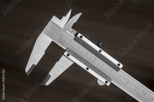 vernier calipers on dark background