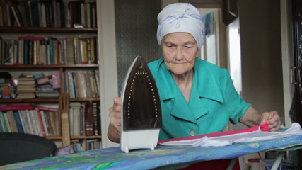 old woman at ironing board