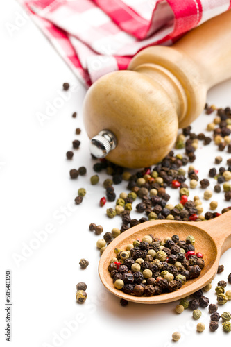 pepper and wooden pepper mill