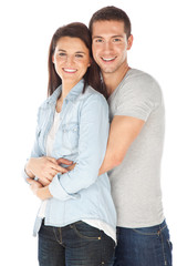 Cheerful young couple standing on white background