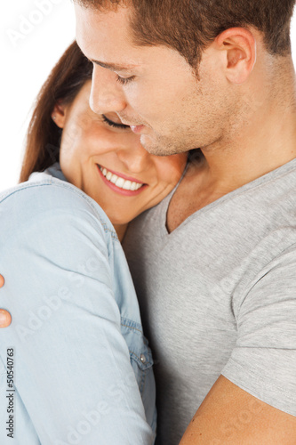 Closeup of young couple embraced