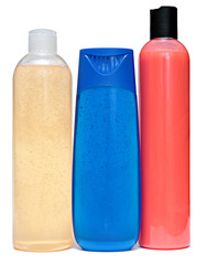 colored plastic bottles with liquid soap and shower gel