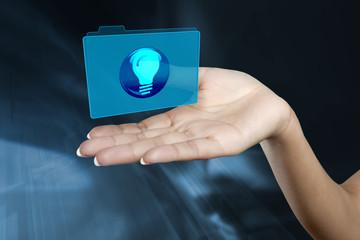a digital folder floats on a woman's hand
