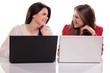 two girls having fun on their laptops