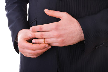 Business man taking off his wedding ring.