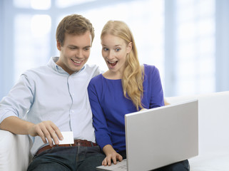 Young couple shopping in internet with credit card