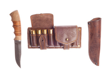 knife with scabbard and bandolier with hunting cartridges on a w