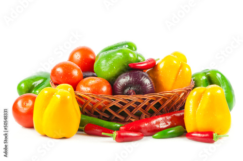 Fresh vegetables in basket isolated on white. Bio Vegetable.  Co