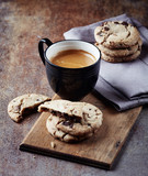 Cup of coffee with chocolate chip cookies