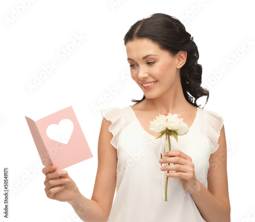 young woman holding flower and postcard