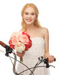 country girl with bicycle and flowers