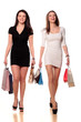 two pretty girls smiling and walking with shopping bags