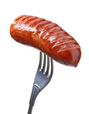 Grilled smoked sausage on a fork