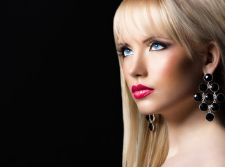 Portrait of young beautiful blonde woman with perfect makeup