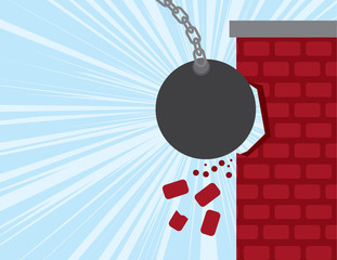 Wrecking ball smashing into a brick building