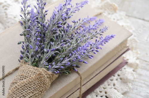 Bunch of lavender placed on book bundle