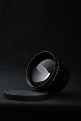 Camera lens close up on black background