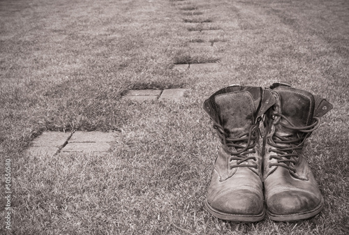 Old boots next to an empty path