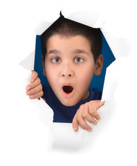 Surprised boy looking through paper hole isolated