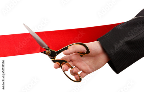 Cutting red ribbon, isolated on white