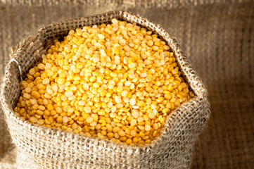 Raw moong dhal in jute bag