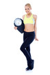 Full body of blond sporty woman holding scale