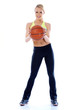 Full body shoot of sporty woman holding basket ball