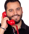 Bearded man speaking by phone