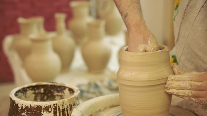 Potter works. Crockery creation process in pottery on potters' w
