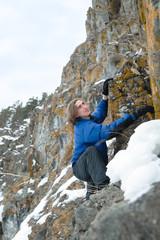 Man climbs the rocks