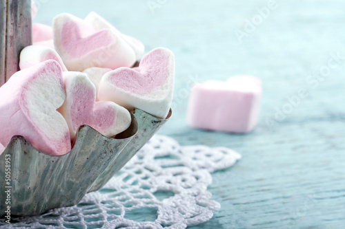 Pink heart shaped marshmallows in a metal cupcake