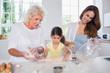 Multi-generation family women baking together