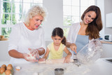 Multi-generation family women baking together