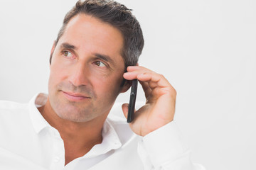Man phoning and looking away