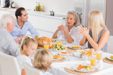 Family enjoying the thanksgiving dinner