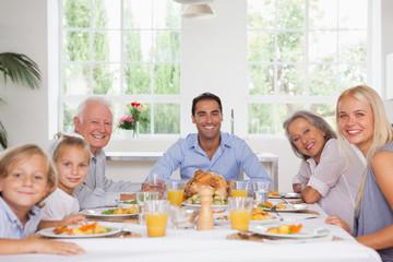 Family smiling at thanksgiving