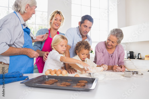 Family preparing biscuits together