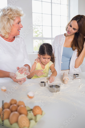 Women of a family baking together
