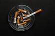 Burning cigarette left in ashtray