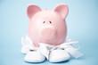Piggy bank wearing baby booties