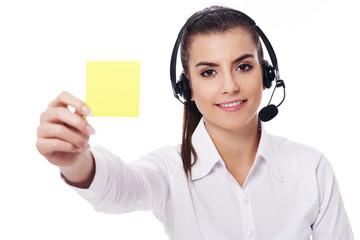 Female operator holding yellow note
