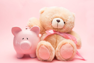 Teddy bear and piggy bank
