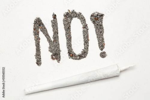 No with exclamation mark spelled out in ash with a joint