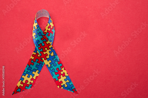 Ribbon for autism and aspergers awareness with copy space